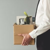 Businessman leaving with box of belongings